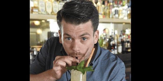 bartender sipping a mojito and looking at camera